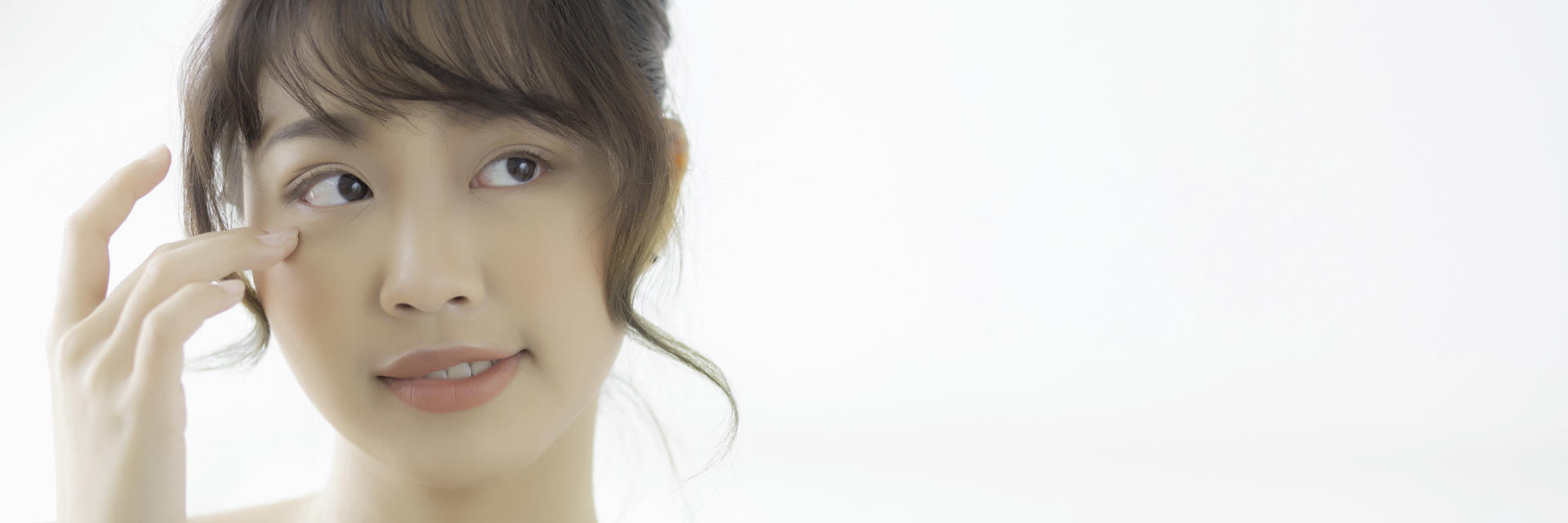 Face of young Asian woman with double eyelid after eyelid surgery.