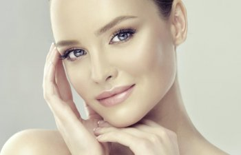 Face of a beautiful woman after facial and dermal filler treatments