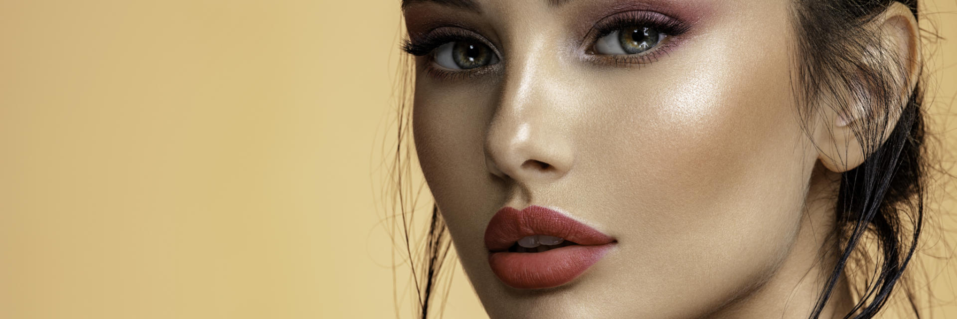 face of a young woman after facial filler treatment
