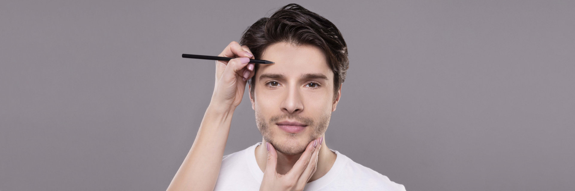 plastic surgeon drawing lines on a man's face before cosmetic facial surgery